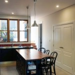 Kitchen with inbuilt laundry cupboards